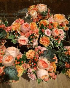 Beautiful peach and coral bridesmaid bouquets...who doesn't love this amazing color combination?  To learn more about Flowers by Tammy, a Tri-Ciites wedding florist, click the linked image above. Photo credit: Flowers By Tammy Facebook