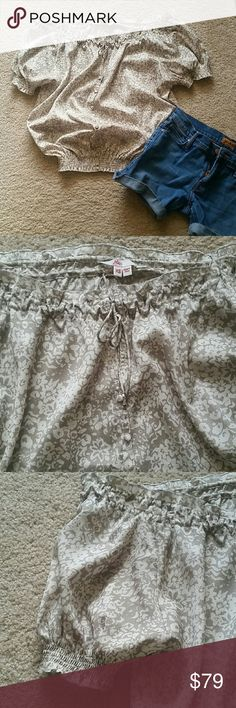 Beautiful JOIE Off the Shoulder Top XS So feminine and on trend! Taupe/Tan and cream floral pattern. Superficial buttons down the front. Smocked at bottom, edges of sleeves and neckline; easily worn off shoulder. So cute! Perfect condition! Joie Tops Blouses