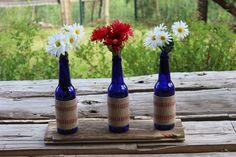 simple 4th decor (budweiser platinum bottles, ribbon, red/white flowers)
