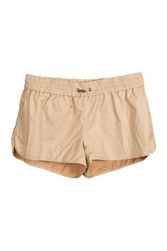 nude leather shorts + white tank on top and saucony bullets on bottom