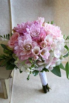 antique green hydrangea, pink dahlias, pink roses, pink freesia and seeded eucalyptus