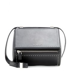 Givenchy - Pandora Box Medium leather shoulder bag - A modern accessory loaded with attitude, Givenchy's 'Pandora' silhouette is a must for the cool crowd. Crafted in Italy from smooth leather with an adjustable shoulder strap, the architectural style is finished with a silver-tone logo and dainty studs that make it a masterclass in street style. Wear it next to neutrals to channel urban chic. seen @ www.mytheresa.com