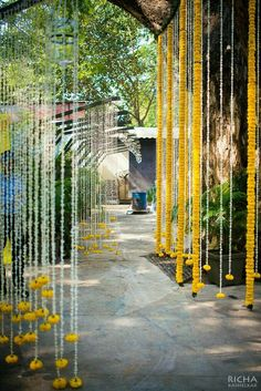 We love the idea of decorating the wedding entrance with strings of marigold and mogra flowers. We love the idea of decorating the wedding entrance with strings of marigold and mogra flowers. Marriage Decoration, Wedding Stage Decorations, Diwali Decorations, Wedding Entrance Decoration, Aisle Decorations, House Decorations, Birthday Decorations, Wedding Mandap, Wedding Ceremony