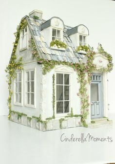"""Bienvenue Cottage is a custom dollhouse I just finished. This one is all white and grays. This house is 20 1/4"""" tall x 15"""" deep x 12 3/4"""" across. The exterior is a combination of plaster and concre"""