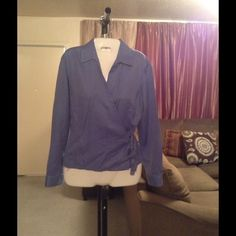 "Ann Taylor Wrap Around Top Ann Taylor Wrap Around Top is made of 100% Cotton. Size 6. Long sleeve. The color is blue. Tie on left side of this top. Laying flat ""18. Length ""24. Arm Length ""18.5. This item is NOT new, It is used and in Good condition. Authentic and from a Smoke And Pet free home. All Offers through the offer button ONLY.  Ask any questions BEFORE purchase. Please use the Offer button, I WILL NOT negotiate in the comment section. Thank You😃 Ann Taylor Tops"