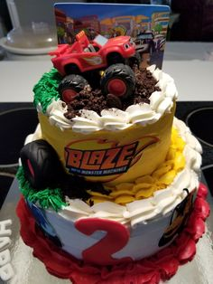 Blaze monster truck theme 2 tier birthday cake !!! Vanilla cake with vanilla buttercream......fondant decor....edible print and crushed oreos for dirt!!!!!