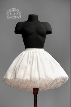 White over skirt over a white ruffle poof petticoat, from below. Very complementary to each other when as here match in length.
