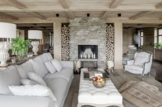 The gray, mixed in with the country chic French inspiration, executes an interior that's reminiscent of a beautiful, dreary day on the countryside. Home Living Room, Living Spaces, Building A Small Cabin, Interior Decorating, Interior Design, Fireplace Design, House In The Woods, Country Chic, Log Homes