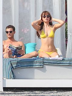Fifty Shades of Yellow! Jamie Dornan and Dakota Johnson Hit the Beach While Filming Fifty Shades Freed http://www.people.com/article/dakota-johnson-jamie-dornan-film-fifty-shades-freed-in-france