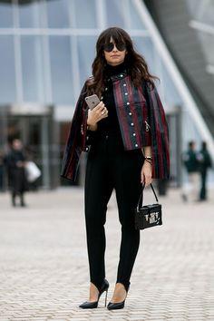 Miroslava Duma, street style during Paris fashion week FW 2015, black peg pants, black shoes, leather jacket.