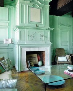 I always think its a shame to paint fabulous moldings the same color as the wall, but in this case I think it works.  Maybe that's just because I'm partial to mint green anything.  Oh and the herringbone wood floors.  I love those.