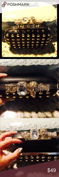 """❤️MUST SEE! NEW-FINGER STUDDED CLUTCH/ARM PURSE!❤️ This is such a Unique and Fun Purse!! It can be used as a clutch or as an arm purse!! It's black with gold colored """"spikes"""". It has a Skull, Bow, Jewel & Owl on the part of the purse you carry with ur hand!! It also has a chain you can attach w a drop of 16inches!! I Love this purse!! Bags Clutches & Wristlets"""