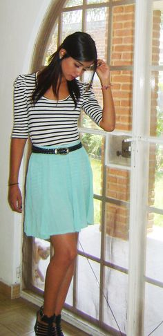 the color of the skirt with the black and white striped shirt