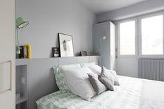 MARCADET | Archipelles PARIS Agency. Modern bright bedroom. Pastel and light gray. Headboard/bookshelf.