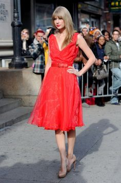 Taylor Swift Taylor Swift wears a vibrant red dress as she arrives for the Billboard 'Woman of the Year' luncheon held in her honor at Capit...