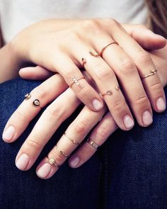 Delicate, thin gold and diamond knuckle rings stacked