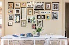 Art display idea: A dining room gallery wall looks amazing with mixed frames and prints in an array of neutrals and styles! Tour more of Sara Ruffin Costello's Striking and Stylish New Orleans Home on Our Style Guide here. Hanging Artwork, Artwork Display, Hanging Photos, Southern Living Homes, New Orleans Homes, Up House, Love Home, Lany, Plates On Wall