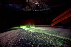 In this incredible shot taken from the International Space Station on March 10, 2012 by Dutch astronaut André Kuipers, we see an absolutely breathtaking view of Aurora Australis (the Southern Lights) between Antarctica and Australia.    An aurora (plural: aurorae or auroras) is a natural light display in the sky particularly in the high latitude (Arctic and Antarctic) regions, caused by the collision of energetic charged particles with atoms in the high altitude atmosphere (thermosphere).