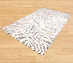 Ambadi - Hand Woven, Hand Knotted, Rugs and Carpet exporter in India