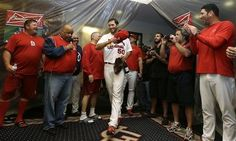 pitcher Adam Wainwright enters the locker room after the Cardinals defeated the Pittsburgh Pirates 6-1 in Game 5 of the NLDS  10-09-13