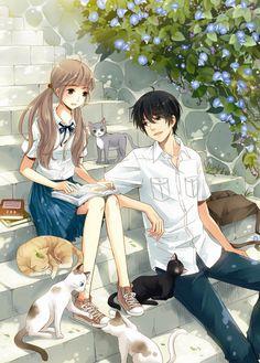 #階段の上にカップルがいます、それから周りに五匹の猫がいる。