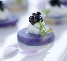 Blue potato canapé with caviar