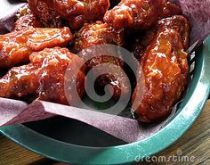 Closeup of a basket of honey garlic chicken wings.