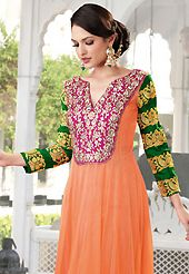 This season dazzle and shine in pure colors. The dazzling light orange faux georgette churidar suit have amazing embroidery patch work is done with resham, zari, stone and beads work. Beautiful embroidery work on kameez is stunning. The entire ensemble makes an excellent wear. Contrasting pink santoon churidar and pink chiffon dupatta is available with this suit. Slight Color variations are possible due to differing screen and photograph resolutions.