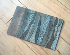 The collagraph plate from the 3rd in a series made from discarded wallpaper samples.