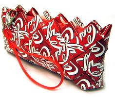 Cute clutch made from recycled coke cans