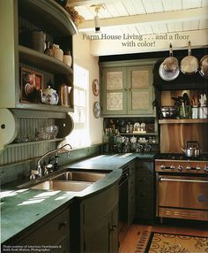 Farm House Living Kitchen...love the punched tin doors on the green cabinets.