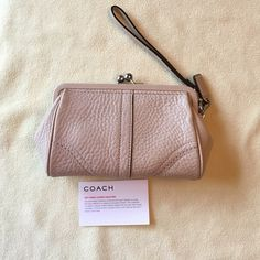 Coach wristlet clutch Coach wristlet clutch with one card slot inside. Nice for a casual evening or day out. 100% authentic. No dust bag! Coach Bags Clutches & Wristlets