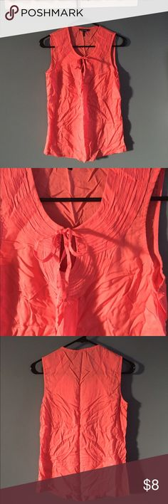 Coral Daisy Fuentes top. Gorgeous color, keyhole with tie closure in front. It's wrinkled, but you can iron it. (I wouldn't see the point in ironing before folding and shipping). Only worn once! Just doesn't fit anymore. Daisy Fuentes Tops Blouses