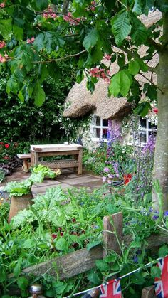 Flower Garden - Flower Garden A true English cottage garden complete with thatched roof, old chopping block as a -