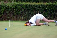 ATTENTION TO DETAIL: A man competed in the croquet championships at Surbiton Croquet Club in Surbiton, England, Wednesday. (Mike King/London News Pictures/Zuma Press)