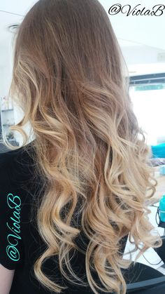 wavy blonde balayage hair hairstyle
