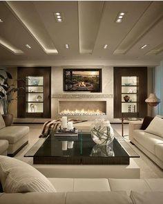 Love the fireplace... . #lovefordesigns#sala#homedecor #homedesign#interiordecor#luxury#newhome#lighting#homeinspo#living#cofferedceiling…
