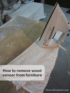 How to remove wood veneer from furniture - with an iron. Tutorial from Decor Adventures.