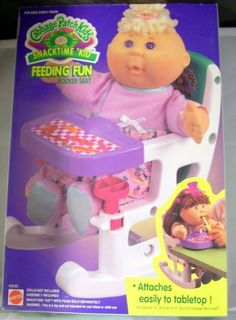 """Cabbage Patch Kids Snacktime 'Kid Feeding Fun Rocker Seat by Mattel. $30.00. Assembly required. Attaches easily to tabletop. Doll and food sold separately. For use with 12"""" Cabbage Patch Kids. Now you can have your best friend sitting right next to you at the table! Put your Cabbage Patch Kid in the rocker seat and attach it to the table! Later during playtime, you can rock your little friend in his or her new seat!"""