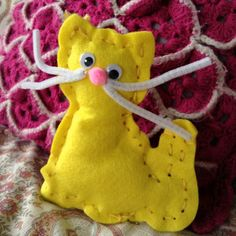 Felt crafts | yellow stuffed cat pipe cleaner whiskers