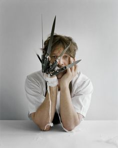 Tim Walker. Rene Redzepi with knives, Copenhagen, Denmark. Vogue US, 2010.