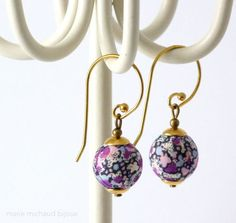 Lovely Liberty textile earrings made with tiny wooden beads covered with purple and black Liberty print fabric, various brass components including beautiful hooks. Please keep these lovely textile earrings away from water, make-up and household products. Enjoy the pleasure of wearing original designer jewelry! Each one of my creations has been made with great skills, patience and care.  Original hand crafted jewelry. Very light earrings. Nickel and lead free. Total height (from top of hook…