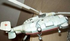 This aircraft paper model is aKamov Ka-27(NATO reporting name Helix),a military helicopter developed for the Soviet Navy, the papercraft is created by DI-3, the scale is in 1:48. There is anotherKamov Ka-27 Paper Model on the site.
