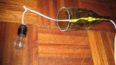 Remodelaholic | How to Make a Glass Wine Bottle Pendant Light DIY (includes cutting the bottom of the wine bottle)