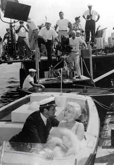 Marilyn and Tony Curtis receiving direction from Billy Wilder on the set of Some Like It Hot, 1958.