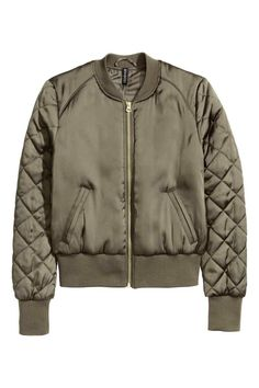 Bomber jacket: Padded bomber jacket in a satin weave with a zip at the front, side pockets, ribbing with a slight sheen at the neckline, cuffs and hem and quilted sleeves. Lined.
