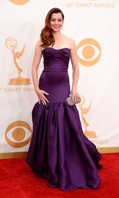 Alyson Hannigan looked to the glamour of yesteryear with side-swept hair and a dramatic, deep purple gown with mermaid skirt.
