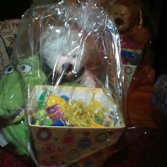 Big basket with white huggable bear green blanket Big basket with eggs candy and toys white stuffed animal and a green alligator warm banket Other