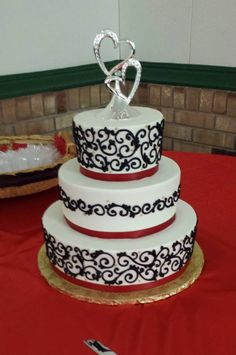 Red and black tiered wedding cake. Black and red wedding. Black and red themed wedding cake. Tiered Wedding Cake. Michigan Wedding. Black Wedding Cake