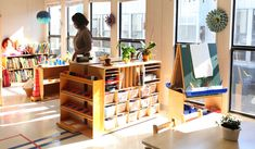 A montessori classroom - chalk board holder in deep shelves, I like the metal insets placement